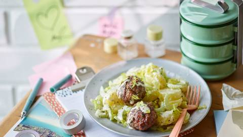 Potato and celery salad with garlic meatballs