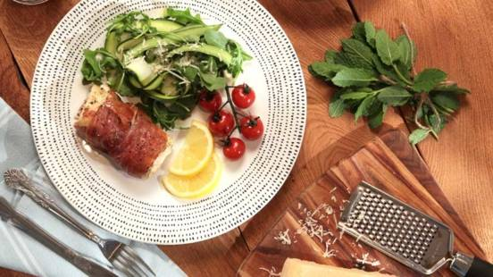 Inismara Sea Bass Fillet Wrapped in Prosciutto Ham, with Courgette, Lemon and Rocket Salad