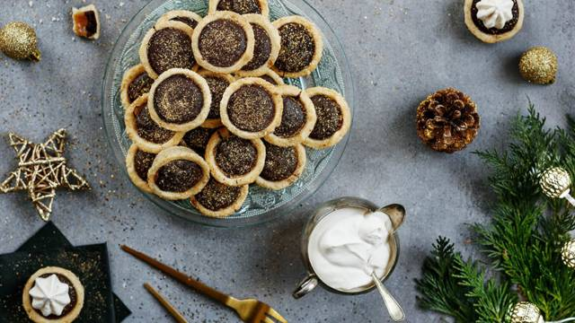 Mini chocolate tartlets with brandy whipped cream