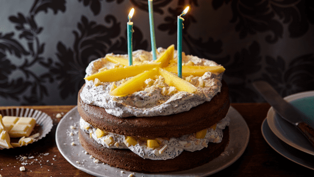 Chocolate cake with poppy cream and mango