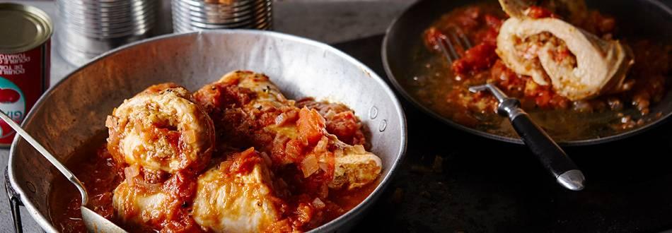 Stuffed chicken rolls on a tomato sauce